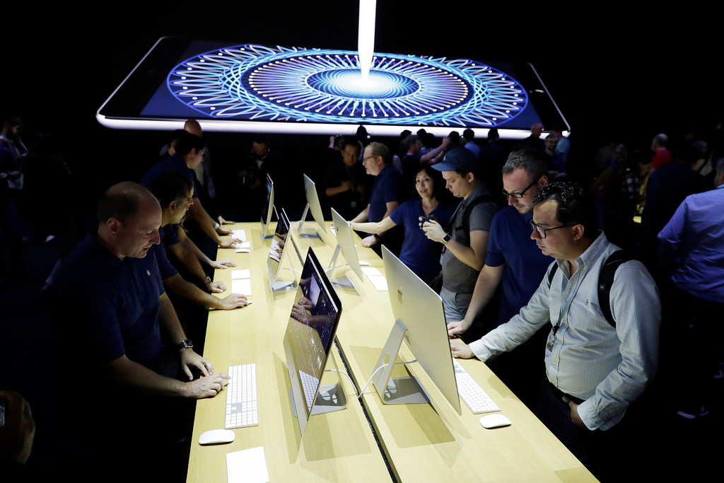 . Journalists look at new iMacs in a showroom during an announcement of new products at the Apple Worldwide Developers Conference Monday, June 5, 2017, in San Jose , Calif. (AP Photo/Marcio Jose Sanchez)