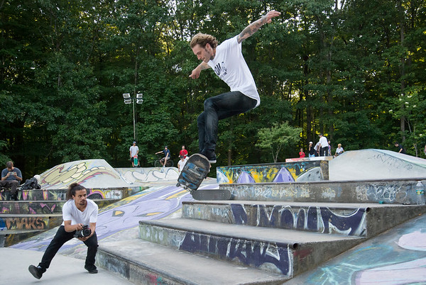 06/21/19 Wesley Bunnell | Staff New Britain held a grand opening for its Stanley Quarter Park Skate Park on Friday June 21, 2019. Brent Cordy performs a skateboard trick as he is filmed by Carlos Ramos.