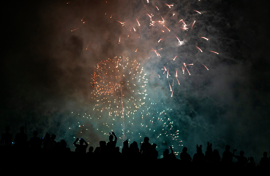 . Spectators watch a fireworks display on the east side of Manhattan borough, as part of Independence Day festivities Wednesday, July 4, 2018, in New York. (AP Photo/Craig Ruttle)