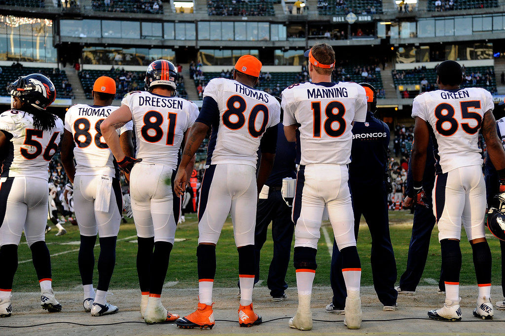 . The Denver Broncos starters stand on the sideline in the second half of their game against the Oakland Raiders at O.co Coliseum December 29, 2013 Oakland, Calif. (Photo By Joe Amon/The Denver Post)