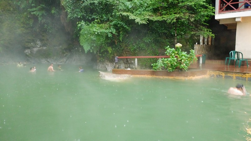various people in a natural hot spring
