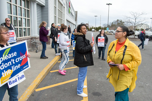 04/11/19 Wesley Bunnell | Staff Stop & Shop workers on strike stand near the entrances to the store in New Britain on Thursday afternoon. Carol Collins, L, asks a customer, R, about to enter to store to not cross the line but he woman entered then left a few minutes later empty-handed.