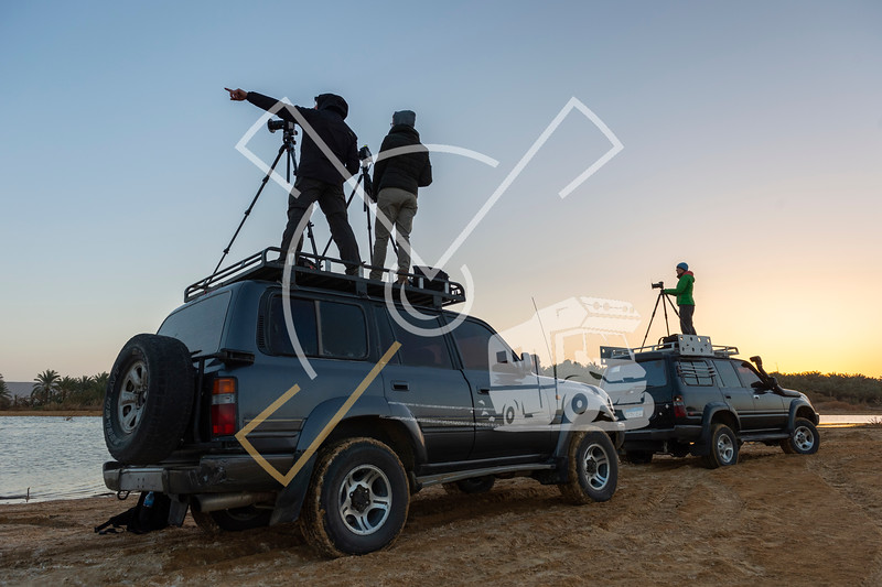 landscape photographers on the roof of toyota jeeps during a photography tour in Egypt.