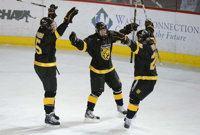. DENVER, CO. - FEBRUARY 08: Jordan DiGlando of Colorado College #14, center, celebrates scoring  with Scott Winkler #25, left, and Mike Bolvin #28 February 8, 2013 at Magness Arena in Denver, Colorado. (Photo By Hyoung Chang/The Denver Post)