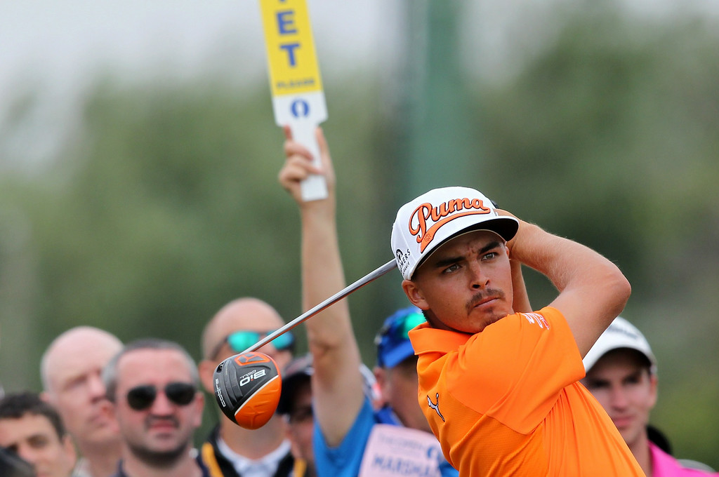. US golfer Rickie Fowler watches his shot from the 10th tee during his fourth round, on the final day of the 2014 British Open Golf Championship at Royal Liverpool Golf Course in Hoylake, north west England on July 20, 2014. PETER MUHLY/AFP/Getty Images