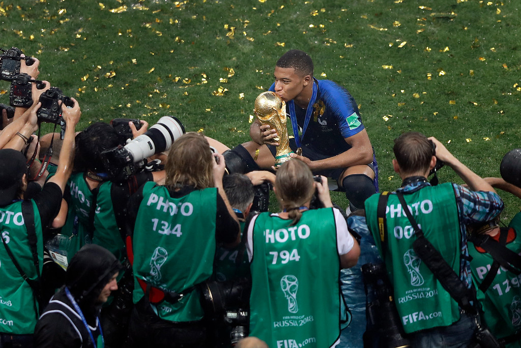 . France\'s Kylian Mbappe kisses the trophy after winning the final match between France and Croatia at the 2018 soccer World Cup in the Luzhniki Stadium in Moscow, Russia, Sunday, July 15, 2018. (AP Photo/Frank Augstein)