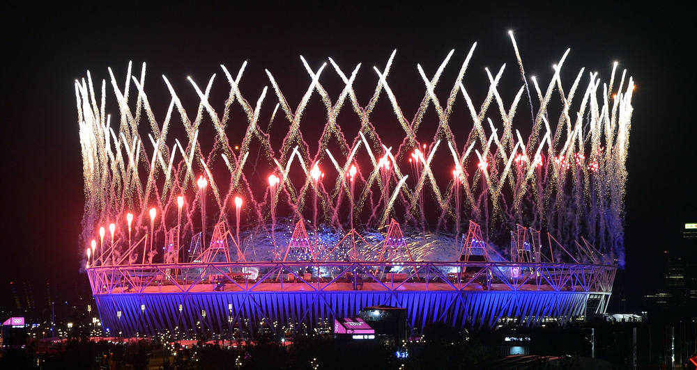 Description of . Fireworks light up the Olympic Stadium during the opening ceremony of the London 2012 Olympic Games in London on July 28, 2012.   AFP PHOTO/Indranil  MUKHERJEE/AFP/Getty Images