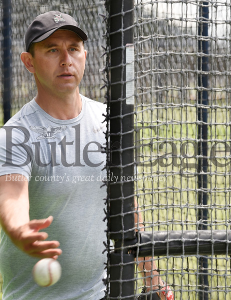 Harold Aughton/Butler Eagle: Ken Krause of Mars pitches to his son Kyle, 12, while practing Wednesday, June 24, 2020.