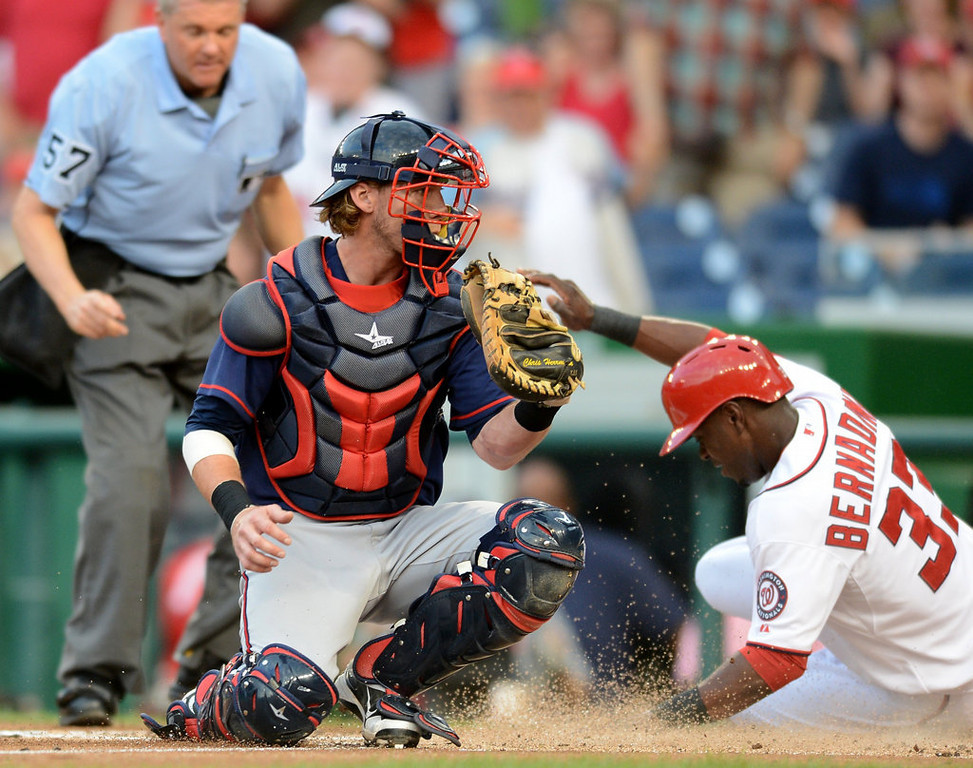 . Washington Nationals left fielder Roger Bernadina (33) scores ahead of a tag by Minnesota Twins catcher Chris Herrmann (12) in the first inning of the second game of a day-night doubleheader at Nationals Park. (Chuck Myers/MCT)
