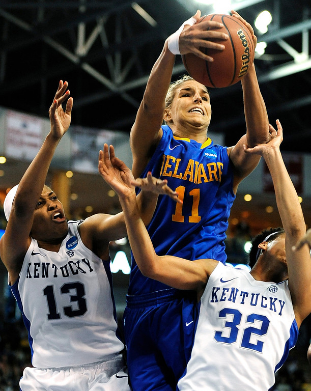 . Delaware\'s Elena Delle Donne (11) pulls down a defensive rebound against Kentucky\'s Bria Goss (13) and Kastine Evans (32) during the second half of a regional semifinal in the NCAA college basketball tournament in Bridgeport, Conn., Saturday, March 30, 2013. Kentucky won 69-62. (AP Photo/Jessica Hill)