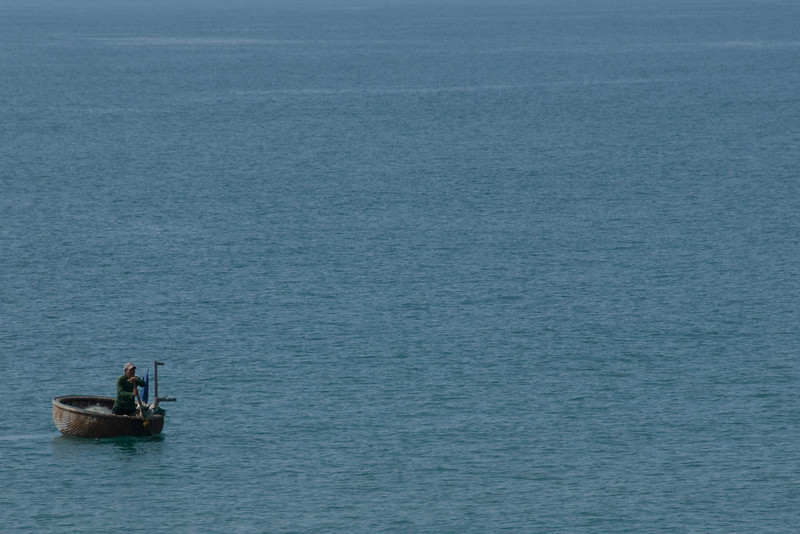 Man on a fishing boat -  Mui Ne, Vietnam