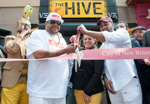 06/07/18 Wesley Bunnell | Staff The Hive in downtown New Britain held a ribbon cutting ceremony on Thursday afternoon after a soft opening earlier in the year. The shop carries New Britain clothing as well as an assortment of small electronics. Co-owner Steve Ayala, Mayor Erin Stewart and co-owner Damon King cut the ribbon as DJ Stevey Newnez, L, announces.