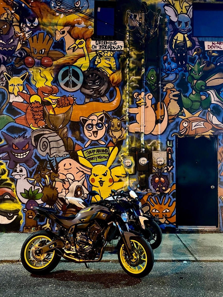 A pair of Yamaha FZ07s in front of the Pokemon Mural in Huntington, New York