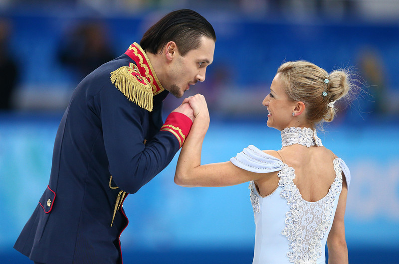 . Tatiana Volosozhar and Maxim Trankov of Russia compete in the Figure Skating Pairs Short Program during the Sochi 2014 Winter Olympics at Iceberg Skating Palace on February 6, 2014 in Sochi, Russia.  (Photo by Clive Mason/Getty Images)