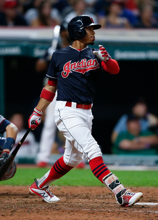 . Cleveland Indians\' Francisco Lindor hits a sacrifice fly off Minnesota Twins relief pitcher Alan Busenitz scoring Jason Kipnis during the sixth inning in a baseball game, Tuesday, Sept. 26, 2017, in Cleveland. (AP Photo/Ron Schwane)