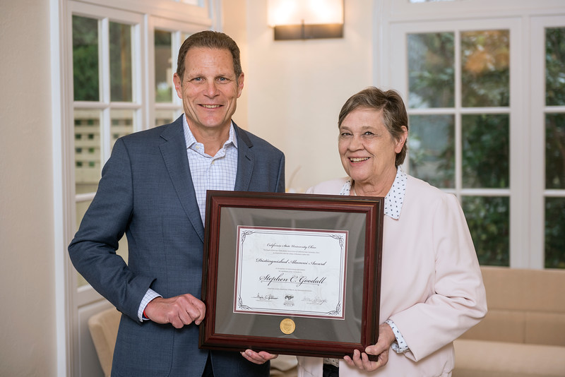 College of Business Distinguished Alumni Stephen C. Goodall (BA, Business/Psychology, 1978) (left) receives recognition by Judith Hennessey (Dean, BUS) (right) on Friday, March 24, 2017 in Chico, Calif. (Jason Halley/University Photographer)