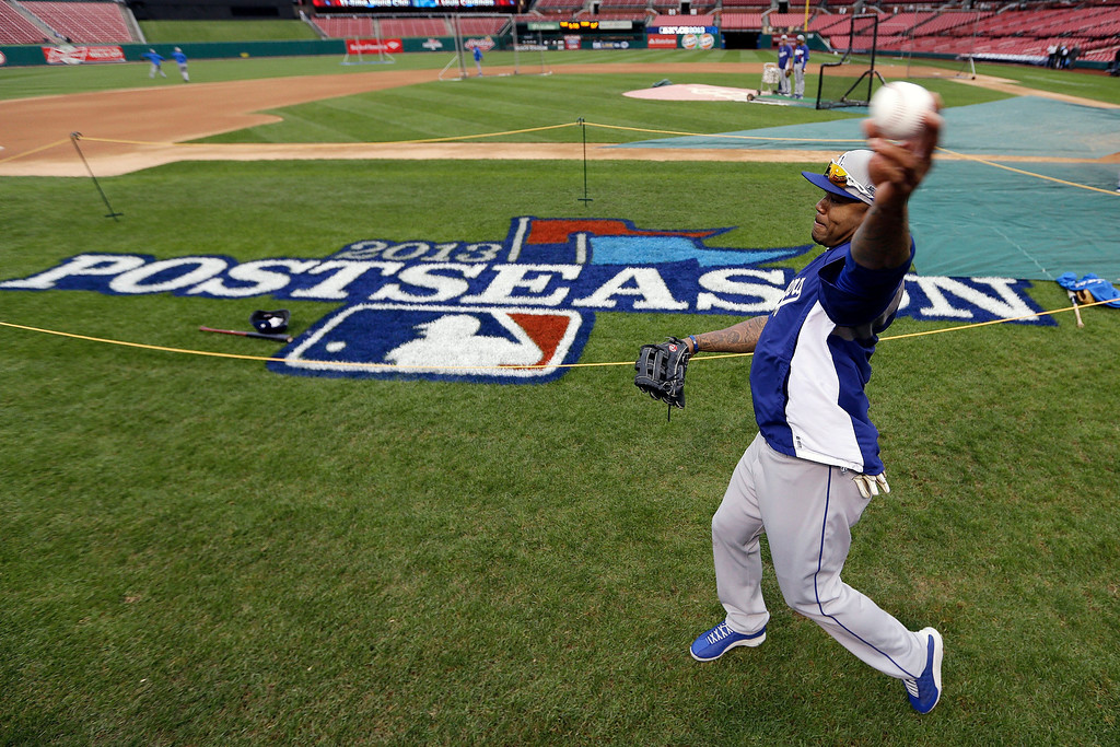 . Los Angeles Dodgers\' Carl Crawford warms up before Game 6 of the National League baseball championship series against the St. Louis Cardinals, Friday, Oct. 18, 2013, in St. Louis. (AP Photo/David J. Phillip)