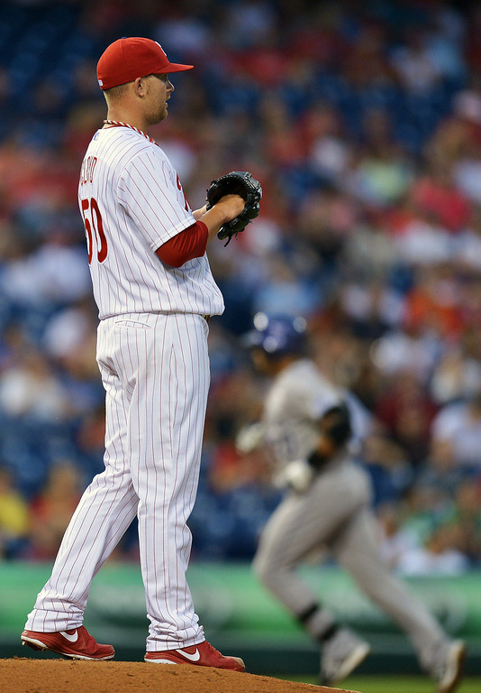 . Tyler Cloyd #50 of the Philadelphia Phillies waits on the mound as Wilin Rosario #20 of the Colorado Rockies rounds the bases after hitting a home run in the third inning at Citizens Bank Park on August 20, 2013 in Philadelphia, Pennsylvania. (Photo by Drew Hallowell/Getty Images)