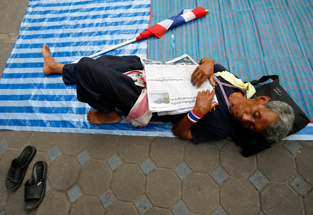 . A Thai anti-government protester sleeps on a ground during a rally occupying the Finance Ministry in Bangkok, Thailand, 26 November 2013. EPA/RUNGROJ YONGRIT