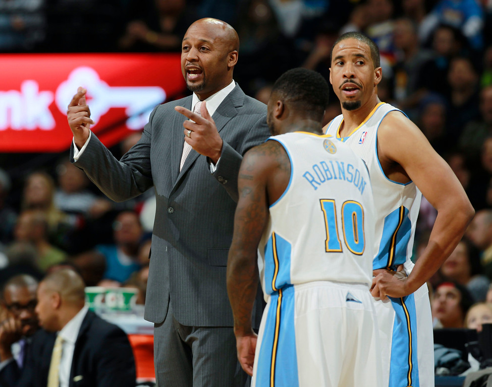 . Denver Nuggets head coach Brian Shaw, left, confers with guards Nate Robinson, front right, and Andre Miller during a time out against the Utah Jazz in the fourth quarter of Utah\'s 103-93 victory in an NBA basketball game in Denver on Friday, Dec. 13, 2013. (AP Photo/David Zalubowski)