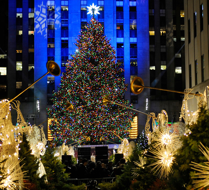 . The Rockefeller Center Christmas tree stands lit during the 78th annual lighting ceremony Tuesday, Nov. 30 , 2010 in New York. (AP Photo/Stephen Chernin)