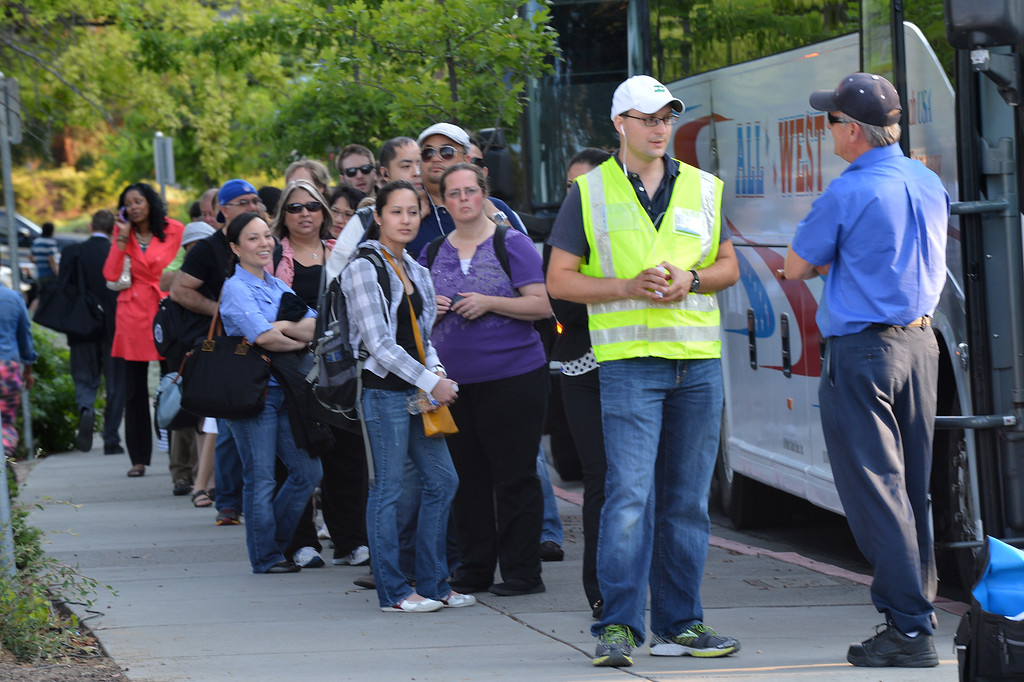 . A long line of commuters works their way down California Boulevard to a line of buses waiting to take them to San Francisco on the second day of the BART strike in Walnut Creek, Calif., on Tuesday, July 2, 2013.  (Dan Rosenstrauch/Bay Area News Group)