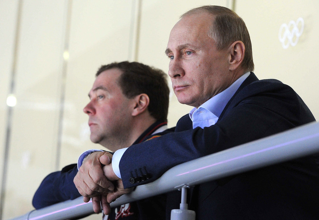 . Russian President Vladimir Putin (R) and Prime Minister Dmitry Medvedev (L) attend the Men\'s Preliminary Round Group A match between Russia and Slovakia at the Bolshoy Ice Dome in the Ice Hockey tournament at the Sochi 2014 Olympic Games in Sochi, Russia, on Feb. 16, 2014.  EPA/MIKHAIL KLIMENTIEV