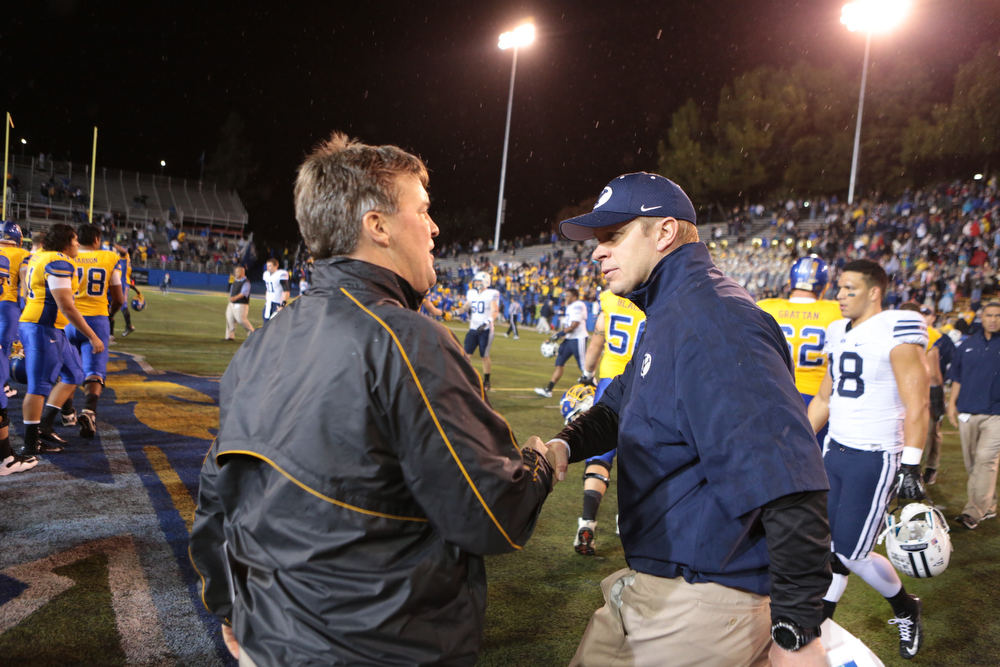 . San Jose State Spartans head coach Mike MacIntyre, left, shakes the hand of Brigham Young Cougars head coach Bronco Mendenhall after the Spartans beat the Cougars in an NCAA college football game in San Jose, Calif., Saturday, Nov. 17, 2012. (AP Photo/John Storey)