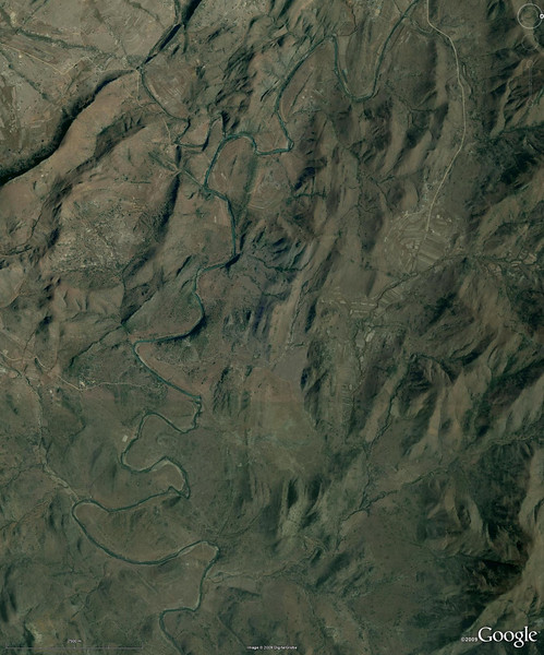 """WoGE #171  It is my pleasure to post a new geo-puzzle after I won Silver Fox's WoGE#170 featuring the New Idria serpentinite diapir in California. I would guess, it was the Almaden mercury mine in The Lost Geologist's WoGE#168 that triggered Silver Fox's mind to come up with New Idria, a historic Hg mine of California. On the other hand, New Idria is a type locality for benitoite, and this is what sparked my mind to give a spin to the game with an additional element. The idea is to choose a new WoGE so that it connects to the previous one by a keyword that should be provided along with the picture (for example, Silver Fox could have picked the keyword  """"mercury mine""""). In the case of my WoGE#171, this keyword would be """"type locality"""". The rules remain the same [the spot should be located (lat, long) and described in geological terms], but to win, one must also explain how the chosen keyword fits into the picture. The simple-to-answer question in this case would be: for what rock is this place the type locality? Let's see if anyone likes the idea."""