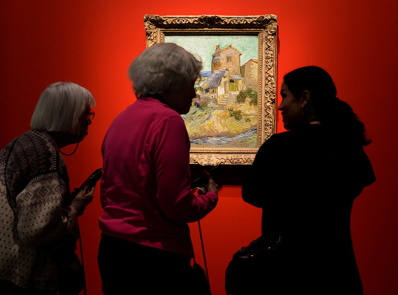 """. The Denver Art Museum just opened it\'s new exhibition, \""""Modern Masters: 20th Century Icons from the Albright-Knox Art Gallery\""""  on Wednesday, March 5,  2014.  Three viewers look at  Vincent van Gogh\'s  painting \""""The Old Mill.\"""" The exhibit shares work of  some of the art world\'s most recognizable names, Picasso, van Gogh, Warhol.    (Denver Post Photo by Cyrus McCrimmon)"""