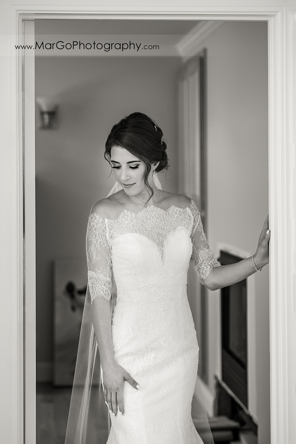 black & white portrait of bride in doorway just before first look tn Walnut Creek