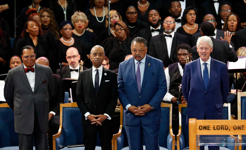 . Louis Farrakhan, from left, Rev. Al Sharpton, Rev. Jesse Jackson and former President Bill Clinton attend the funeral service for Aretha Franklin at Greater Grace Temple, Friday, Aug. 31, 2018, in Detroit. Franklin died Aug. 16, 2018 of pancreatic cancer at the age of 76. (AP Photo/Paul Sancya)
