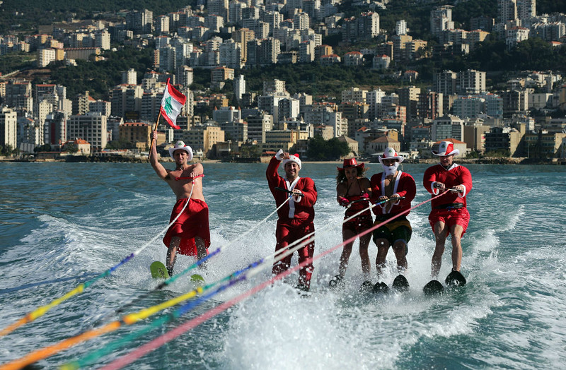 . Members of a Lebanese water ski club wearing a Santa Claus costume, one with a national flag, perform in the bay of Jounieh, north of the Lebanese capital Beirut on December 24, 2014.  PATRICK BAZ/AFP/Getty Images