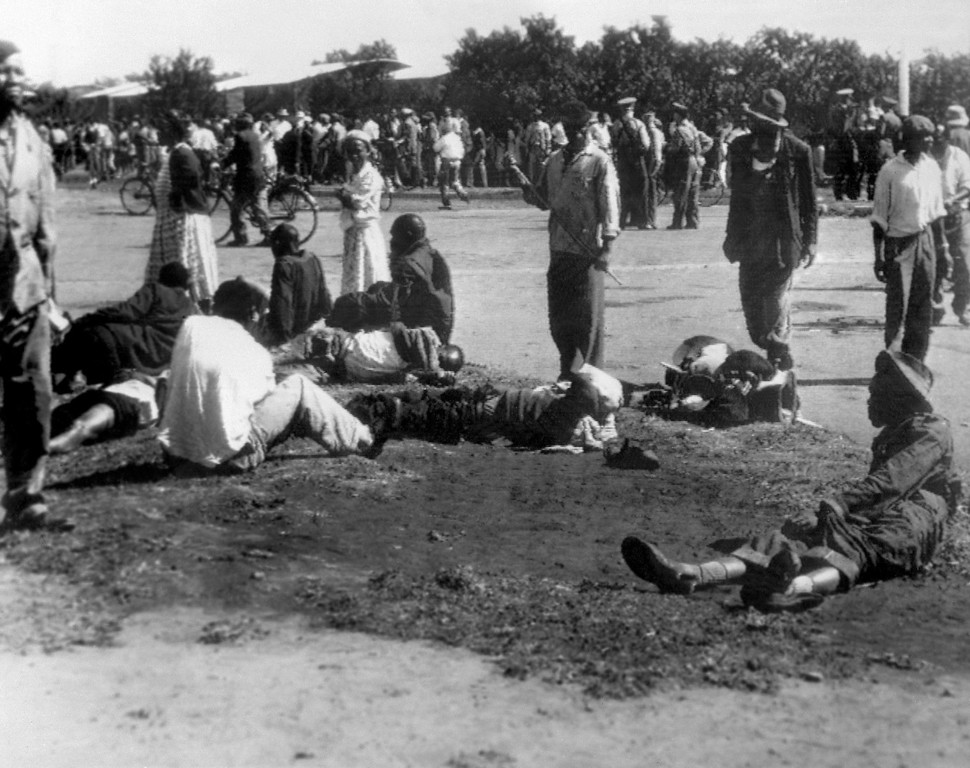 . Wounded people lie in the street, 21 March 1960 in Sharpeville, near Vereeniging, where at least 180 black Africans, most of them women and children, were injured and 69 killed, when South African police opened fire on black protestors. The protest was organized by the Pan Africanist Congress (PAC) against pass laws, which required all blacks to carry pass books (identity cards) at all times. On 30 March 1960, the government declared a state of emergency, detaining more than 18,000 people. The Sharpeville massacre led to the banning of the ANC and PAC and signaled the start of armed resistance in South Africa with the foundation of Umkhonto we Sizwe, the military wing of the ANC, and Poqo, the military wing of the PAC.        (STR/AFP/GettyImages)