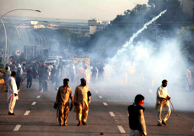. Police use tear gas to disperse protesters in Islamabad, Pakistan, Monday, Sept. 1, 2014. Anti-government protesters stormed Pakistanís state television building Monday, forcing the channel briefly off the air as they clashed with police and pushed closer to the prime ministerís residence. (AP Photo/Anjum Naveed)