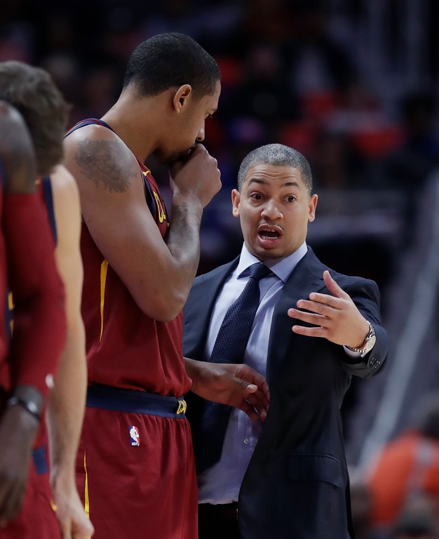 . Cleveland Cavaliers head coach Tyronn Lue talks with forward Channing Frye during the first half of an NBA basketball game against the Detroit Pistons, Monday, Nov. 20, 2017, in Detroit. (AP Photo/Carlos Osorio)
