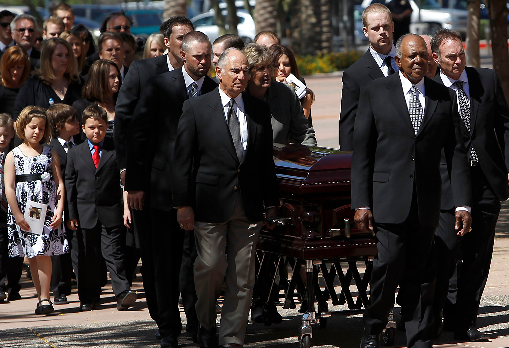 . From left to right, pall bearers and Twins players Joe Nathan, Michael Cuddyer, former teammate Frank Quilici, current Twins player Justin Morneau, former teammate Tony Oliva, and Paul Molitor, lead the casket of Harmon Killebrew prior to the funeral services Friday, May 20, 2011, in Peoria, Ariz. (AP Photo/Ross D. Franklin)