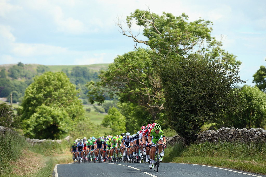 . HARROGATE, ENGLAND - JULY 05:  The peloton rides through Yorkshire Dales during the first stage of the 2014 Tour de France, a 190km stage between Leeds and Harrogate, on July 5, 2014 in Harrogate, England.  (Photo by Bryn Lennon/Getty Images)