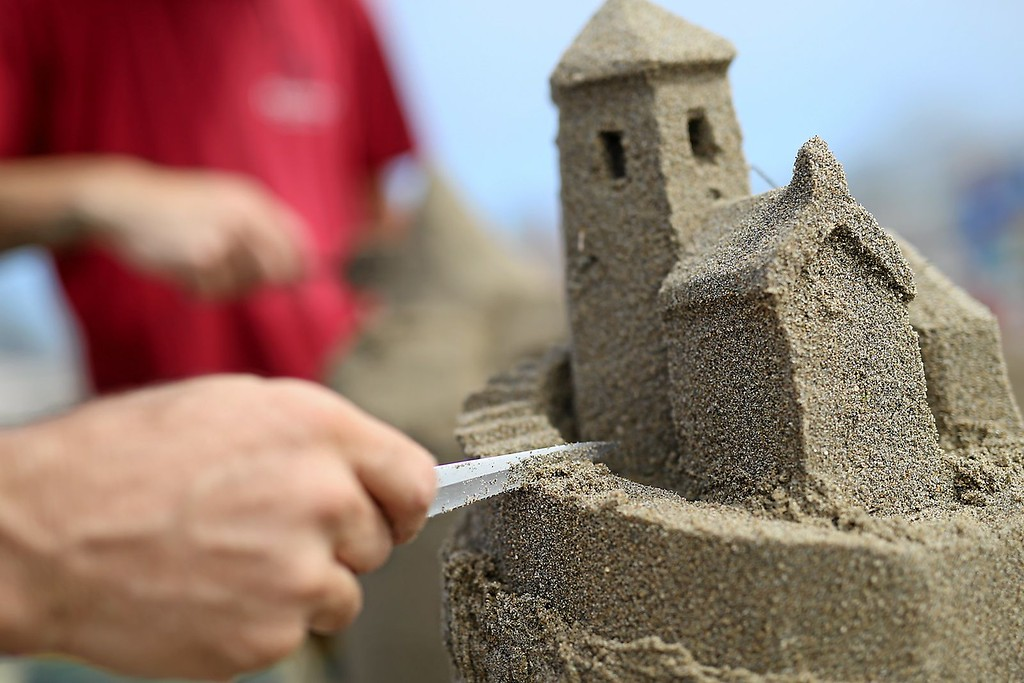 . Jeff Brown carves tiny stairs into his sand castle on Capitola Beach on Saturday during the annual sand castle competition. (Kevin Johnson -- Santa Cruz Sentinel)