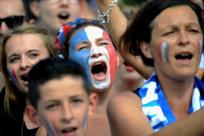 . France fans react on July 4, 2014 as they watch the 2014 FIFA World Cup quarter final football match between France and Germany on a giant screen in Nantes, western France. (JEAN-SEBASTIEN EVRARD/AFP/Getty Images)
