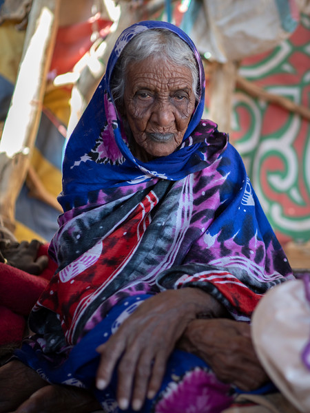 Medina, a 97 year old Hassania nomad sits in her tent in the remote Bayuda desert