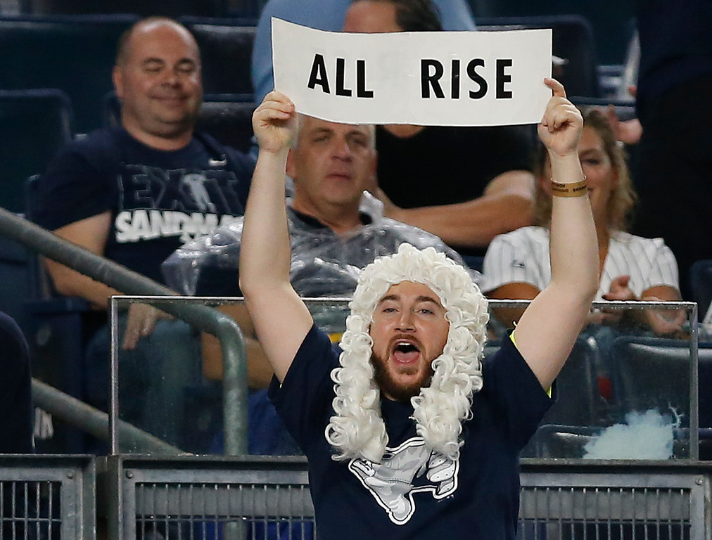 . A New York Yankees fan holds up a sign for New York Yankees\' Aaron Judge during the first inning in Game 4 of baseball\'s American League Division Series, Monday, Oct. 9, 2017, in New York. (AP Photo/Kathy Willens)