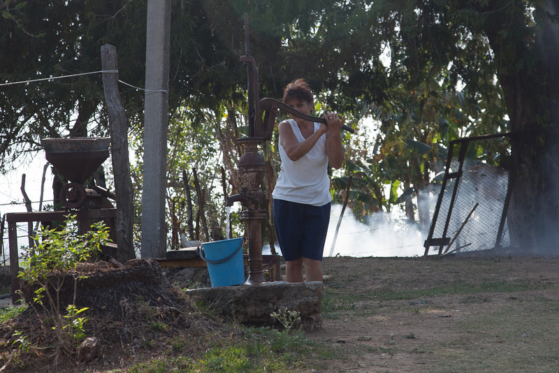 Extracting water from the wale. The smoke behind is from burning the trash.