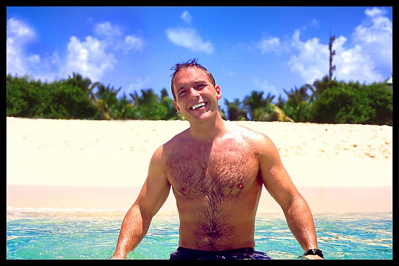 Dawn takes a shot of me in the waters at a beach in the Grand Cayman Islands.   I was hoping to God that she wouldn't get the camera wet!