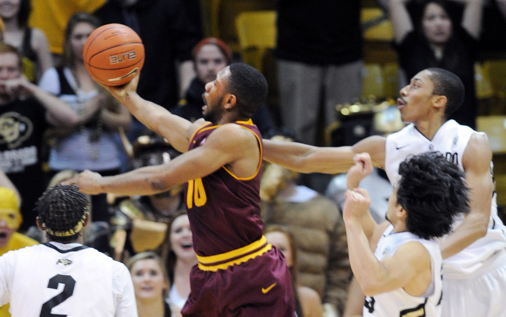 . Evan Gordon of Arizona State puts up the winning shot in overtime past Spencer Dinwiddie during the  February 16th, 2013 game in Boulder. Cliff Grassmick / February 16, 2013