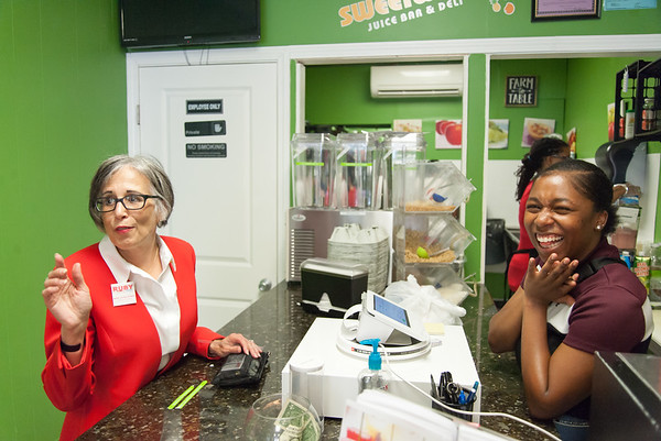 08/02/18 Wesley Bunnell | Staff Ruby Corby O'Neill shares a laugh with Manager Jazmine Schand while waiting for her order at Sweetwater Juice Bar & Deli on Thursday afternoon during a stop on her tour of downtown New Britain. O'Neill is running for for Congress for Connecticut's 5th district.