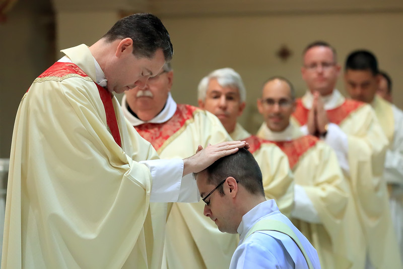 Priests lays hands on Richard Jasper during his Ordination at Cathedral of Saint Peter Church, Saturday, May 20, 2017. wwwDonBlakePhotography.com