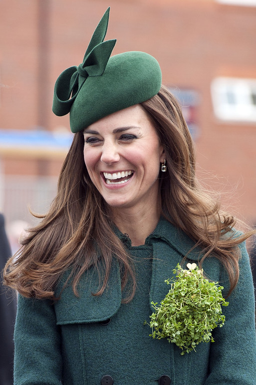 . Catherine, Duchess of Cambridge smiles as she visits the 1st Battalion Irish Guards during the St Patrick\'s Day parade at Mons Barracks on March 17, 2014 in Aldershot, England. Catherine, Duchess of Cambridge and Prince William, Duke of Cambridge visited the 1st Battalion Irish Guards to present the traditional sprigs of Shamrocks to the Officers and Guardsmen of the Regiment.  (Photo by Bradley Page - WPA Pool/Getty Images)