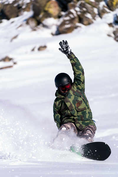 Sean McClendon lays down a heelside turn in some fresh powder while snowboarding at Bogus Basin near Boise, Idaho
