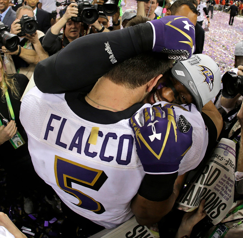 . Baltimore Ravens quarterback Joe Flacco (5) embraces linebacker Ray Lewis after defeating the San Francisco 49ers 34-31 in the NFL Super Bowl XLVII football game, Sunday, Feb. 3, 2013, in New Orleans. (AP Photo/Matt Slocum, File)